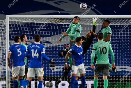 Everton's goalkeeper Robin Olsen (in black) makes a save during the English Premier League match between Brighton & Hove Albion and Everton in Brighton, Britain, 12 April 2021.