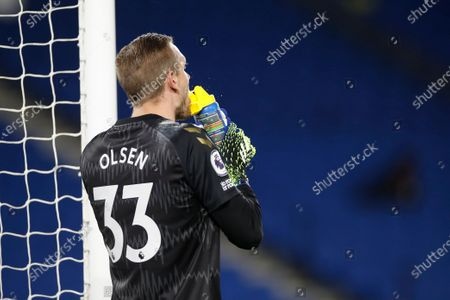 Everton's goalkeeper Robin Olsen refreshes himself during the English Premier League soccer match between Brighton and Everton at the Falmer Stadium in Brighton, England