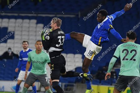 Everton's goalkeeper Robin Olsen makes a save during the English Premier League soccer match between Brighton and Everton at the Falmer Stadium in Brighton, England