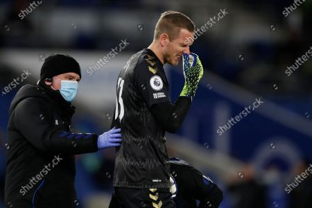 Everton's goalkeeper Robin Olsen receives medical attention during the English Premier League soccer match between Brighton and Everton at the Falmer Stadium in Brighton, England