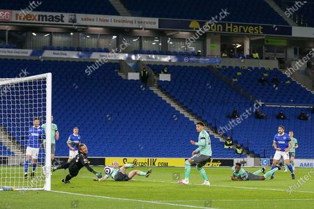 Stock Image of Brighton and Hove Albion forward Neal Maupay (9) shoots Everton goalkeeper Robin Olsen (33) saves during the Premier League match between Brighton and Hove Albion and Everton at the American Express Community Stadium, Brighton and Hove
