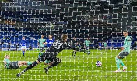 Brighton and Hove Albion forward Neal Maupay (9) shoots at goal \from Everton goalkeeper Robin Olsen (33) and Everton midfielder Tom Davies (26) during the Premier League match between Brighton and Hove Albion and Everton at the American Express Community Stadium, Brighton and Hove
