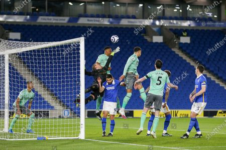 Everton goalkeeper Robin Olsen (33) punches clear from Brighton and Hove Albion forward Neal Maupay (9) during the Premier League match between Brighton and Hove Albion and Everton at the American Express Community Stadium, Brighton and Hove