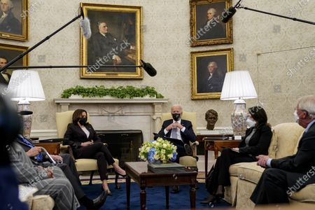 United States President Joe Biden joined by US Vice President Kamala Harris meet with a bipartisan group of Members of Congress to discuss the American Jobs Plan in the Oval Office of the White House in Washington,. Pictured from left to right: Vice President Harris, President Biden, US Senator Maria Cantwell (Democrat of Washington), and US Senator Roger Wicker (Republican of Mississippi)