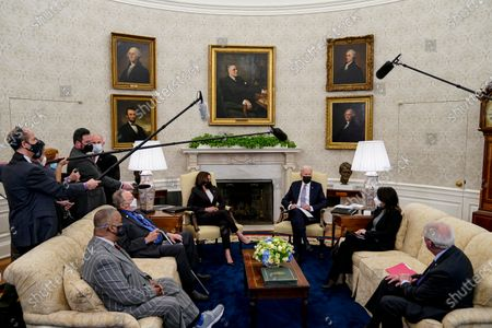 United States President Joe Biden joined by US Vice President Kamala Harris meet with a bipartisan group of Members of Congress to discuss the American Jobs Plan in the Oval Office of the White House in Washington,. Pictured from left to right: US Representative Donald Payne, Jr. (Democrat of New Jersey), US Representative Don Young (Republican of Alaska), Vice President Harris, President Biden, US Senator Maria Cantwell (Democrat of Washington), and US Senator Roger Wicker (Republican of Mississippi).