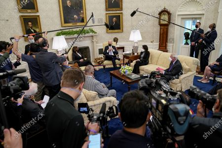 Stock Photo of United States President Joe Biden joined by US Vice President Kamala Harris meet with a bipartisan group of Members of Congress to discuss the American Jobs Plan in the Oval Office of the White House in Washington,. Pictured from left to right: US Representative Donald Payne, Jr. (Democrat of New Jersey), US Representative Don Young (Republican of Alaska), Vice President Harris, President Biden, US Senator Maria Cantwell (Democrat of Washington), and US Senator Roger Wicker (Republican of Mississippi).