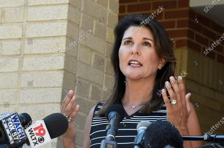 Former South Carolina Gov. Nikki Haley speaks with reporters after a campus tour of South Carolina State University, in Orangeburg, S.C. Haley, often mentioned as a possible 2024 GOP presidential contender, said Monday that she would not seek her party's nomination if former President Donald Trump opts to run a second time