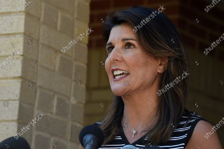 Former South Carolina Gov. Nikki Haley speaks with reporters after a tour of the campus of South Carolina State University, in Orangeburg, S.C. Haley, often mentioned as a possible 2024 GOP presidential contender, said Monday that she would not seek her party's nomination if former President Donald Trump opts to run a second time