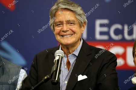Stock Image of Ecuador's president-elect, Guillermo Lasso, holds a press conference at the Dann Carlton hotel in Quito, Ecuador, 12 April 2021. With 97.99% of the validated minutes, Lasso has 52.48% of the votes, while his rival Andres Arauz, supported by former President Rafael Correa, accumulates 47.52%.