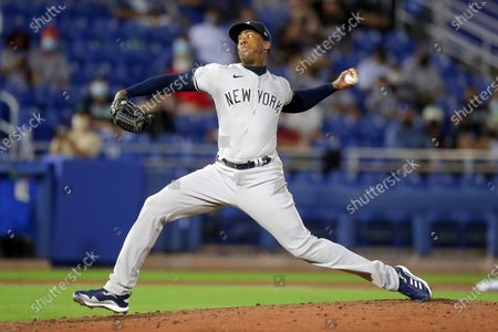 Stock Photo of New York Yankees relief pitcher Aroldis Chapman throws against the Toronto Blue Jays during the ninth inning of a baseball game, in Dunedin, Fla