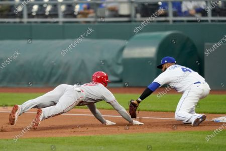 Stock Image of Los Angeles Angels' Shohei Ohtani, left, is tagged out by Kansas City Royals first baseman Carlos Santana (41) during the first inning of a baseball game at Kauffman Stadium in Kansas City, Mo., . Ohtani was picked off by Royals starting pitcher Brady Singer