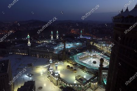 Muslims pray during the first dawn prayers of the Islamic holy month of Ramadan, at the Grand Mosque, in the Muslim holy city of Mecca, Saudi Arabia, . During Ramadan, the holiest month in Islamic calendar, Muslims refrain from eating, drinking, smoking and sex from dawn to dusk