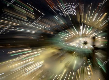 With a slow shutter speed, the Kaaba, the cubic building at the Grand Mosque, is seen in the Muslim holy city of Mecca, Saudi Arabia, . During Ramadan, the holiest month in Islamic calendar, Muslims refrain from eating, drinking, smoking and sex from dawn to dusk
