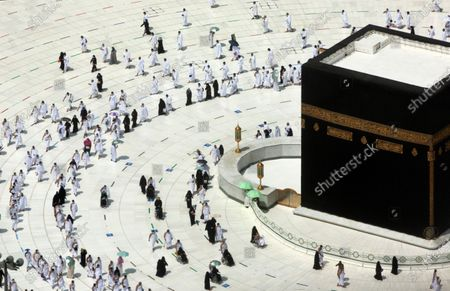 Muslim pilgrims circumambulate around the Kaaba, the cubic building at the Grand Mosque, during the minor pilgrimage, known as Umrah, marking the holy month of Ramadan, in the Muslim holy city of Mecca, Saudi Arabia, . During Ramadan, the holiest month in Islamic calendar, Muslims refrain from eating, drinking, smoking and sex from dawn to dusk