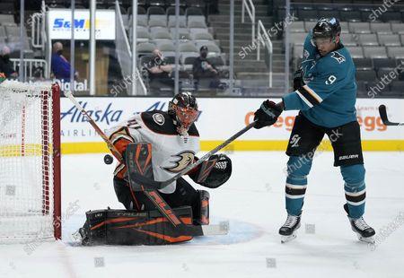 Anaheim Ducks goaltender Anthony Stolarz (41) blocks a shot by San Jose Sharks left wing Evander Kane (9) during the first period of an NHL hockey game, in San Jose, Calif