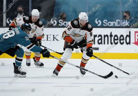 Stock Image of Anaheim Ducks right wing Alexander Volkov (92) skates past San Jose Sharks defenseman Mario Ferraro (38) during the second period of an NHL hockey game, in San Jose, Calif