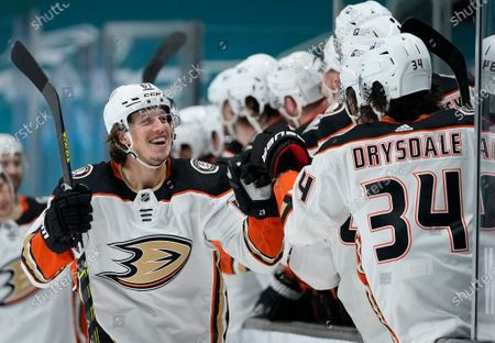 Stock Picture of Anaheim Ducks center Rickard Rakell (67) is congratulated by players on the bench after scoring a goal against the San Jose Sharks during the third period of an NHL hockey game, in San Jose, Calif. Anaheim won 4-0