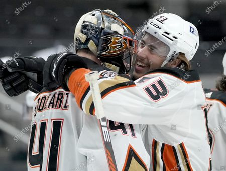 Anaheim Ducks left wing Max Comtois (53) hugs goaltender Anthony Stolarz (41) after a 4-0 victory against the San Jose Sharks in a NHL hockey game, in San Jose, Calif