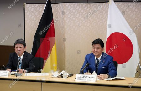 Japan's Foreign Minister Toshimitsu Motegi (L) and Defence Minister Nobuo Kishi (R) attend a video conference with German Foreign Minister Heiko Maas (not pictured) and Defence Minister Annegret Kramp-Karrenbauer (not pictured) at the Foreign Ministry in Tokyo, Japan, 13 April 2021. The two countries held Foreign and Defense Ministerial Meeting, '2+2', to strengthen their cooperation.
