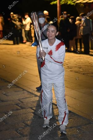 Naomi Kawase, the film director of official film for the 2020 Tokyo Olympics, poses during the Tokyo 2020 Olympic torch relay in Nara city, Nara Prefecture, Japan.