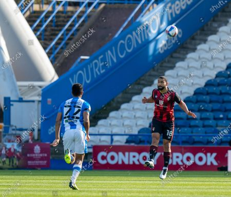 Cameron Carter-Vickers of Bournemouth heads clear with Fraizer Campbell of Huddersfield Town closing down Strictly Editorial Use Only. No use with unauthorized audio, video, data, fixture lists, club/league logos or 'live' services. Online in-match use limited to 120 images, no video emulation. No use in betting, games or single club/league/player publications; The John Smiths Stadium, Huddersfield, Yorkshire, England; English Football League Championship Football, Huddersfield Town versus Bournemouth.