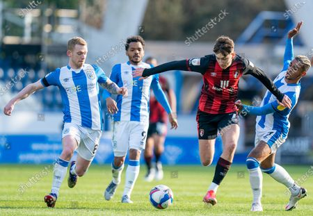 David Brooks of Bournemouth breaks past Juninho Bacuna, Jonathan Hogg and Duane Holmes of Huddersfield Town; The John Smiths Stadium, Huddersfield, Yorkshire, England; English Football League Championship Football, Huddersfield Town versus Bournemouth.