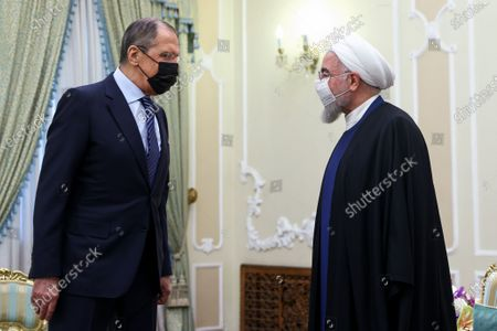 Stock Picture of In this photo released by Russian Foreign Ministry Press Service, Iranian President Hassan Rouhani, right, and Russian Foreign Minister Sergey Lavrov greet each other prior to their talks in Tehran, Iran