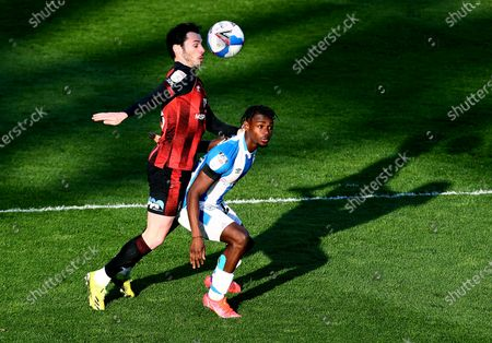 Adam Smith of Bournemouth and Aaron Rowe of Huddersfield Town