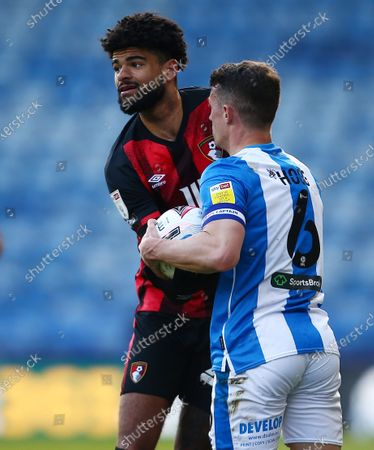 Philip Billing of Bournemouth and Jonathan Hogg of Huddersfield Town