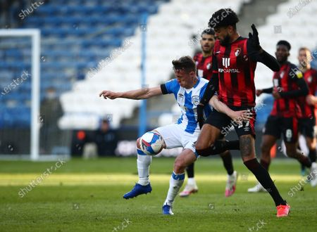 Jonathan Hogg of Huddersfield Town and Philip Billing of Bournemouth
