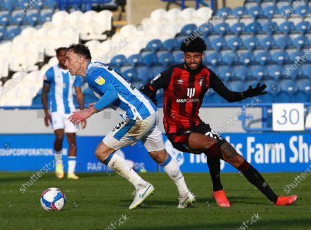 Richard Keogh of Huddersfield Town and Philip Billing of Bournemouth