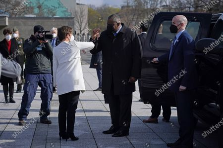 German Defense Minister Annegret Kramp-Karrenbauer (C-L) greets new US Defense Secretary Lloyd Austin (C-R) with a socially-distanced elbow touch at the Defense Ministry amidst the coronavirus pandemic in Berlin, Germany, 13 April 2021. Austin is in Germany as part of a tour in the region that includes stops in Israel, Belgium and the United Kingdom. In Germany he will also visit US military installations.