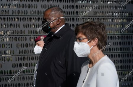 German Defense Minister Annegret Kramp-Karrenbauer (R) and new US Defense Secretary Lloyd Austin (L) follow an honour guard to lay a wreath at a memorial to members of the Bundeswehr, the German armed forces, killed in the line of duty upon Austin's arrival at the Defense Ministry in Berlin, Germany, 13 April 2021. Austin is in Germany as part of a tour in the region that includes stops in Israel, Belgium and the United Kingdom. In Germany he will also visit U.S. military installations.