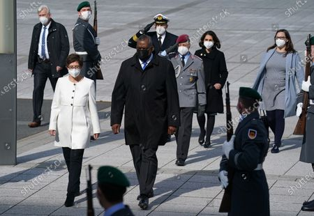 German Defense Minister Annegret Kramp-Karrenbauer (C-L) walks with new US Defense Secretary Lloyd Austin (C) upon his arrival at the Defense Ministry in Berlin, Germany, 13 April 2021. Austin is in Germany as part of a tour in the region that includes stops in Israel, Belgium and the United Kingdom. In Germany he will also visit U.S. military installations.