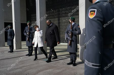 German Defense Minister Annegret Kramp-Karrenbauer (C-L) and new US Defense Secretary Lloyd Austin (C) emerge after laying a wreath at a memorial to members of the Bundeswehr, the German armed forces, killed in the line of duty upon Austin's arrival at the Defense Ministry in Berlin, Germany, 13 April 2021. Austin is in Germany as part of a tour in the region that includes stops in Israel, Belgium and the United Kingdom. In Germany he will also visit U.S. military installations.