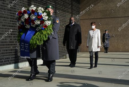 German Defense Minister Annegret Kramp-Karrenbauer (R) and new US Defense Secretary Lloyd Austin (C) follow an honour guard to lay a wreath at a memorial to members of the Bundeswehr, the German armed forces, killed in the line of duty upon Austin's arrival at the Defense Ministry in Berlin, Germany, 13 April 2021. Austin is in Germany as part of a tour in the region that includes stops in Israel, Belgium and the United Kingdom. In Germany he will also visit U.S. military installations.