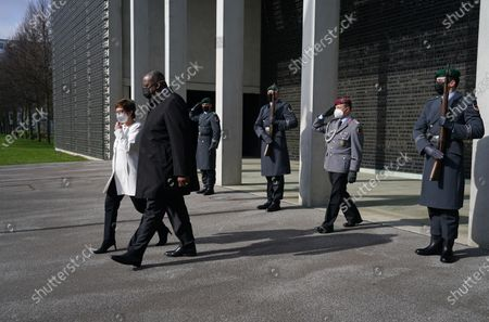 German Defense Minister Annegret Kramp-Karrenbauer (L) and new US Defense Secretary Lloyd Austin (2-L) emerge after laying a wreath at a memorial to members of the 'Bundeswehr', the German armed forces, killed in the line of duty upon Austin's arrival at the Defense Ministry in Berlin, Germany, 13 April 2021. Austin is in Germany as part of a tour in the region that includes stops in Israel, Belgium and the United Kingdom. In Germany he will also visit U.S. military installations.