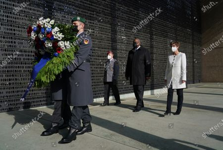 German Defense Minister Annegret Kramp-Karrenbauer (R) and new US Defense Secretary Lloyd Austin (2-R) follow an honour guard to lay a wreath at a memorial to members of the Bundeswehr, the German armed forces, killed in the line of duty upon Austin's arrival at the Defense Ministry in Berlin, Germany, 13 April 2021. Austin is in Germany as part of a tour in the region that includes stops in Israel, Belgium and the United Kingdom. In Germany he will also visit U.S. military installations.