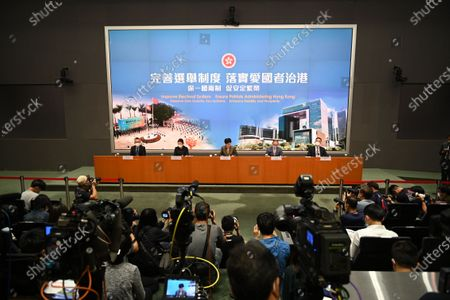 From Left to Right Ms Llewellyn Mui, Acting Officer(Special Duties), Ms Teresa Cheng, Secretary for Justice, Mrs Carrie Lam, Chief Executive of Hong Kong, Mr Eric Tsang, Secretary for constitution and mainland affairs, Mr Roy Tang, permanent secretary for Constitutional and Mainland affairs during a press conference on 'Improving Electoral System' in Hong Kong, China, on April 13, 2021. The government is formally proposing to make it a crime for people to urge others to cast blank or spoiled ballots, or not vote at all, as it unveiled a host of bills to amend local laws in line with the sweeping electoral reforms initiated by Beijing last month. It would also be a crime to obstruct or prevent people from casting a ballot. Both offences would be punishable by up to three years in prison, The paper also laid out detailed arrangements for how the expanded 1,500-member Election Committee will be selected in an election to be held on September 19, The powerful body will nominate all legislators and select 40 of them through block-voting, That means each member selects 40 members, and the 40 individuals with the most votes at the end will win the seats, All members will be required to swear allegiance to the SAR, and vow to uphold the Basic Law, The Election Committee would also keep its current role of choosing the chief executive, with the next election set for March 27, Authorities also unveiled the 10 new geographical constituencies that will return 20 of the 90 new legislators to be chosen on December 19. The paper also laid out detailed arrangements for how the expanded 1,500-member Election Committee will be selected in an election to be held on September 19.