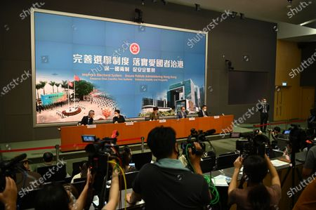 From Left to Right Ms Llewellyn Mui, Acting Officer(Special Duties), Ms Teresa Cheng, Secretary for Justice, Mrs Carrie Lam, Chief Executive of Hong Kong, Mr Eric Tsang, Secretary for constitution and mainland affairs, Mr Roy Tang, permanent secretary for Constitutional and Mainland affairs during a press conference on 'Improving