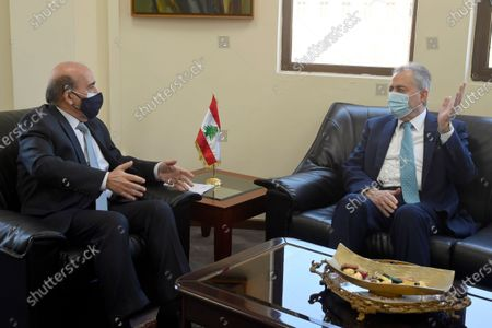 Lebanese Minister of Foreign Affairs Charbel Wehbe (L) meeting with the Syrian ambassador to Lebanon Ali Abdul Karim (R) at the Foreign Ministry in Beirut, Lebanon, 13 April 2021. According to the demarcation, the Syrian side grabbed a Lebanese area of 750 square kilometers from Block Number-1, where the Russian company for oil and gas exploration process will begin. Lebanon had previously demarcated its maritime borders in 2011, and in 2014 launched a round of primary licenses and invited bids for Block Number-1 in the north. But Syria did not recognize the Lebanese demarcation.