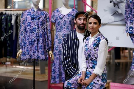 Spanish fashion designer Juan Vidal (L), who has already created dresses for Lady Gaga and Kendall Jenner, poses next to Laura Corsini (R), founder of Spanish clothing brand 'Bimani', during the presentation of his new collection for the label on the sidelines of the Madrid Fashion Week in Madrid, Spain, 13 April 2021.