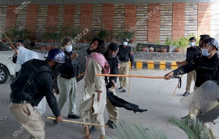 Stock Photo of Police officers hit a supporter of Tehreek-e-Labiak Pakistan, a radical Islamist political party, before detain him at a protest against the arrest of their party leader, Saad Rizvi, in Peshawar, Pakistan, . Two demonstrators and a policeman were killed Tuesday in violent clashes between Islamists and police in Pakistan, hours after authorities arrested Rizvi in the eastern city of Lahore, a senior official and local media reported
