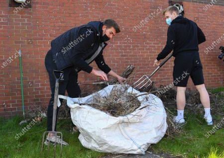 Stock Photo of Alex Palmer and Anthony Scully of Lincoln City help members of the Sincil Community Land Trust create a garden near Lincoln City's home stadium during the EFL Day of Action