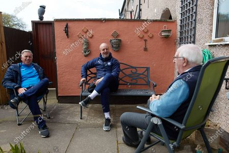 Tranmere Rovers manager Keith Hill and Tranmere Community Trust manager Steve Williams visit dementia  Richard Calvert and his wife Doreen in their back garden