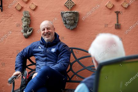 Stock Picture of Tranmere Rovers manager Keith Hill and Tranmere Community Trust manager Steve Williams visit dementia  Richard Calvert and his wife Doreen in their back garden