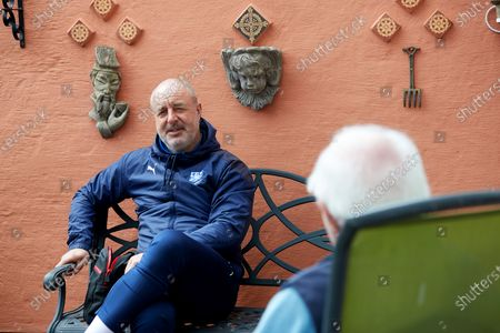 Stock Photo of Tranmere Rovers manager Keith Hill and Tranmere Community Trust manager Steve Williams visit dementia  Richard Calvert and his wife Doreen in their back garden
