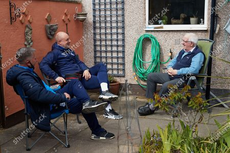 Stock Image of Tranmere Rovers manager Keith Hill and Tranmere Community Trust manager Steve Williams visit dementia  Richard Calvert and his wife Doreen in their back garden