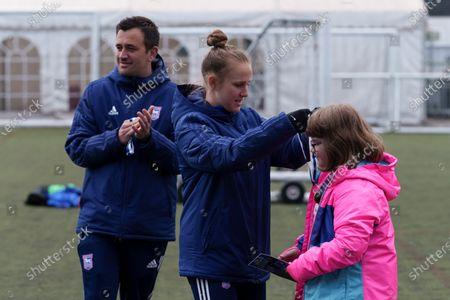 Ipswich Town Women's Eva Hubbard works with local school children during the EFL Day of Action / Girls Football Festival at Portman Road.
