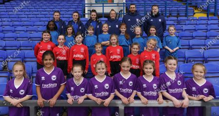 Local schools take part in the EFL Day of Action at Portman Road. School children taking part  pose with Ipswich Town Women's players and coaching staff. (L-R) Maddie Biggs, Sophie Peskett, Maria Boswell, Eva Hubbard, Joe Sheehan and Charlie Baxter